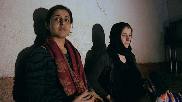 Activist Nareen Shammo, left, has been keeping tracks of hundreds of kidnapped women and is helping Hamshe, right, to try to return to 'normal' life after 28 days in captivity as a sex slave