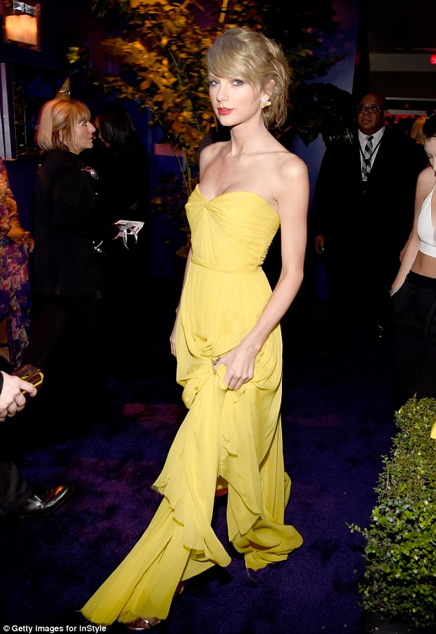 Mellow yellow: Taylor looked sensational in her long yellow gown