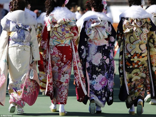Flower power: A huge variety of kimono designs were on display as 1.26 million celebrated turning 20