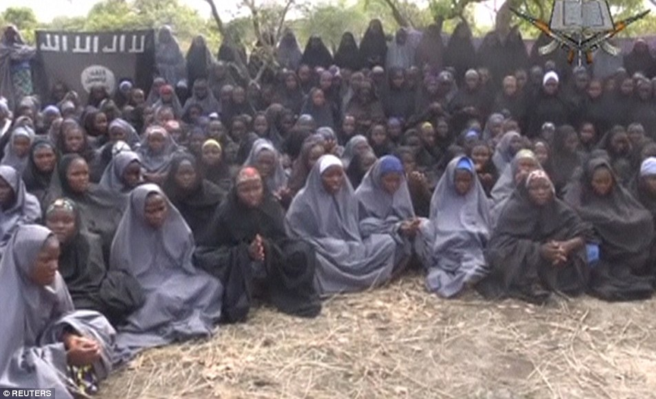 Innocent victims: Kidnapped schoolgirls are seen at an unknown location in this image taken from a video released by Boko Haram. The girls went missing in April 2014.