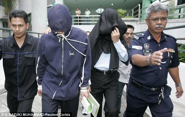 Policemen Azilah Hadri and Sirul Azhar Umar, found guilty of her murder, arrive at court  in 2009