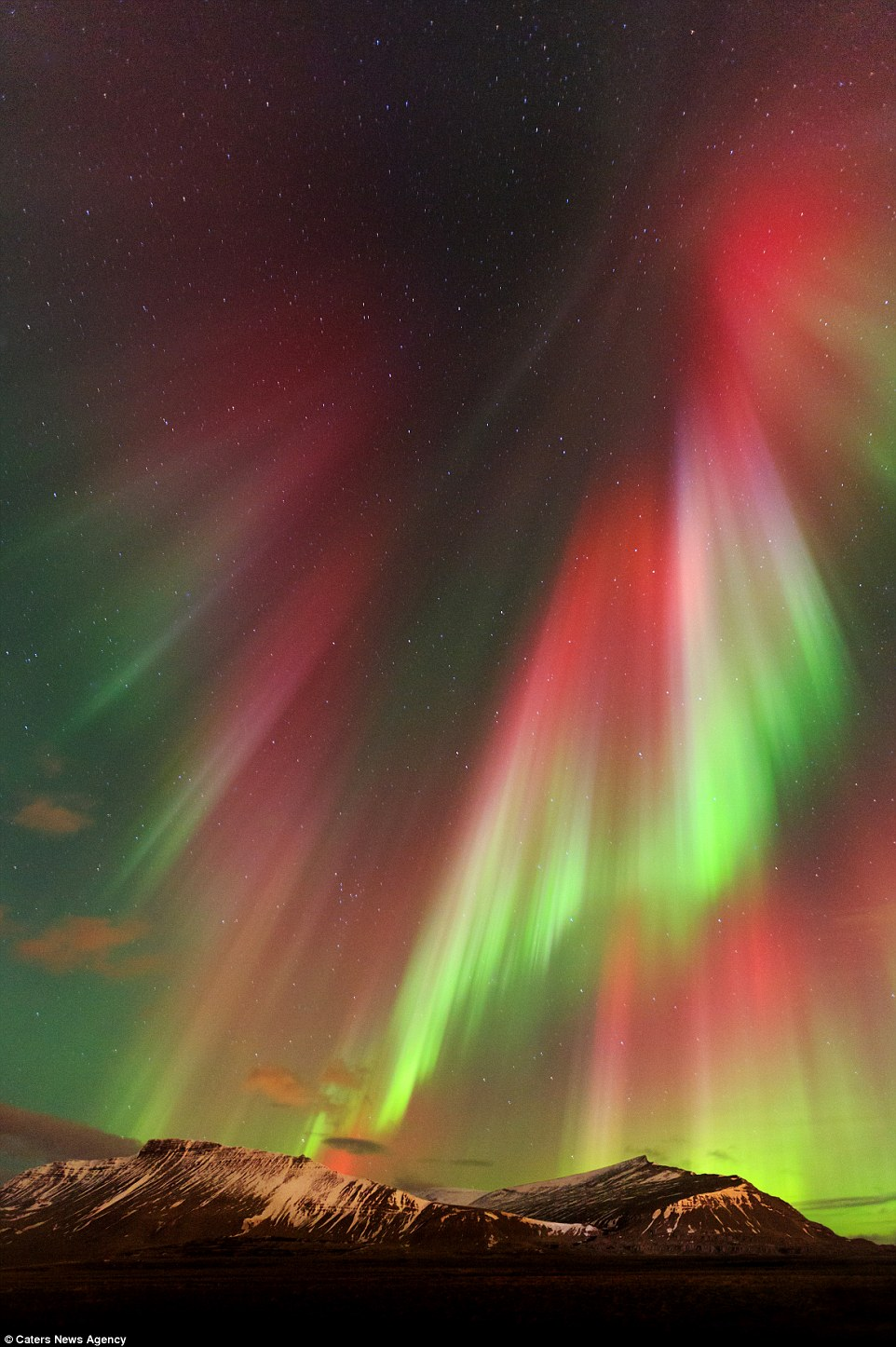 Image Of Christ The Redeemer Appears In Aurora Borealis