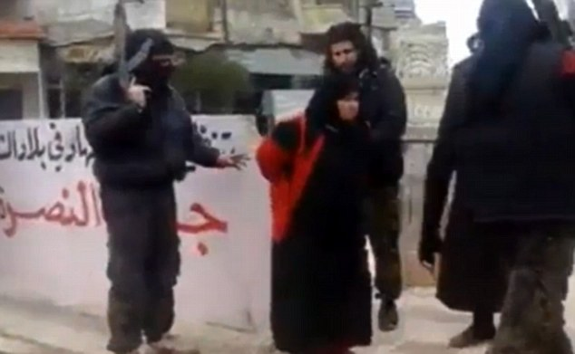 Condemned to die: Footage has emerged on social media of a veiled woman being publicly executed by an Al Qaeda splinter group in Syria for alleged adultery - a sentence that has sickened even Islamic State militants