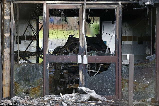 The foyer of the building was completely destroyed and appears to show the remains of the burnt car