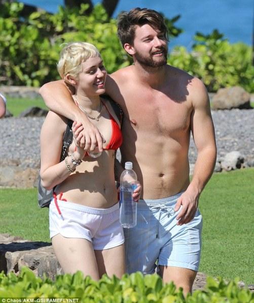 Paradise: Miley Cyrus and boyfriend Patrick Schwarzenegger enjoyeda sunny seaside hike on the island of Maui in Hawaii on Sunday
