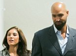 KIRKLAND, WA - NOVEMBER 04:  Hope Solo and husband Jerramy Stevens exit the court room at Kirkland Municipal Court on November 4, 2014 in Kirkland, Washington.  Solo is charged with assault after police were called to an alleged domestic dispute with her half-sister and nephew in June.  (Photo by Suzi Pratt/Getty Images)