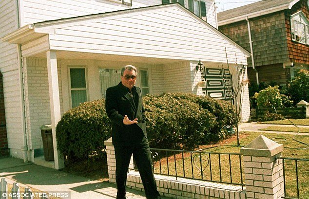 Mafia boss Gotti leaves his modest Howard Beach home 1987 in to visit the grave site of his youngest son Frank, who was run over by a car in 1980