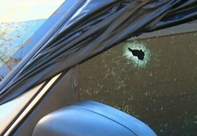 A bullet was fired through the windshield after a gunman opened fire at a Florida high school on Friday night