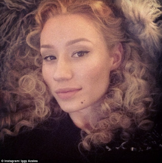 Voluminous locks: Iggy Azalea took to Instagram on Friday to show off her impressive curls