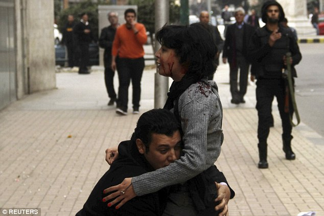 Socialist Popular Alliance Party activist Shaima al-Sabbagh (middle) was shot and died of birdshot wounds during clashes with Egyptian police during a protest in central Cairo today on the eve of the anniversary of the 2011 uprising against Hosni Mubarak