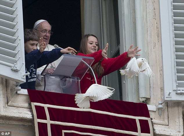 Contrast: Last year the Pope released two doves in St Peter's Square during the equivalent ceremony