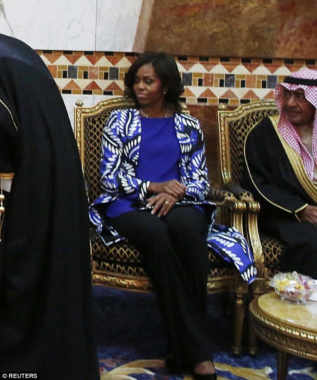 All by her lonesome: The First Lady sat silently while King Salman's entourage courted her husband