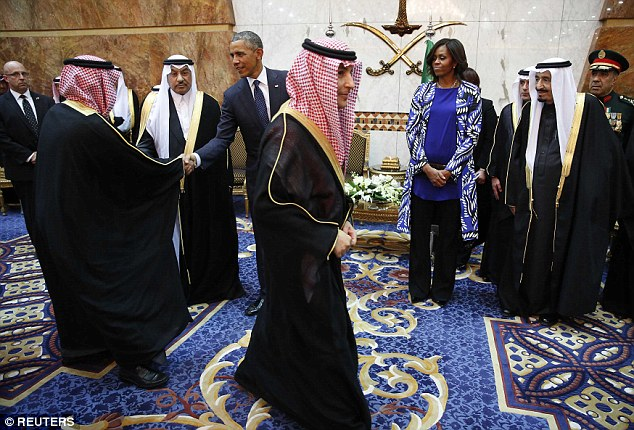 On their terms: Reporters who traveled with the president and First Lady said she purposely stood back from her husband and waiting for the Saudi men to approach her first for a handshake. She mostly just stood and smiled as they passed though