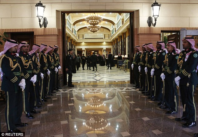 The palace guards stood at attention for the American guests during the brief Tuesday visit