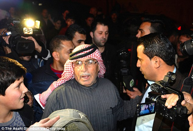 Stress: Safi al-Kaseasbeh, the father of Jordanian pilot Muath al-Kaseasbeh who has been taken hostage by ISIS, is seen after meeting with Jordan's King Abdullah II following a protest by the pilot's relatives at the entrance to the royal palace to ensure the government does all it can to secure his son's release