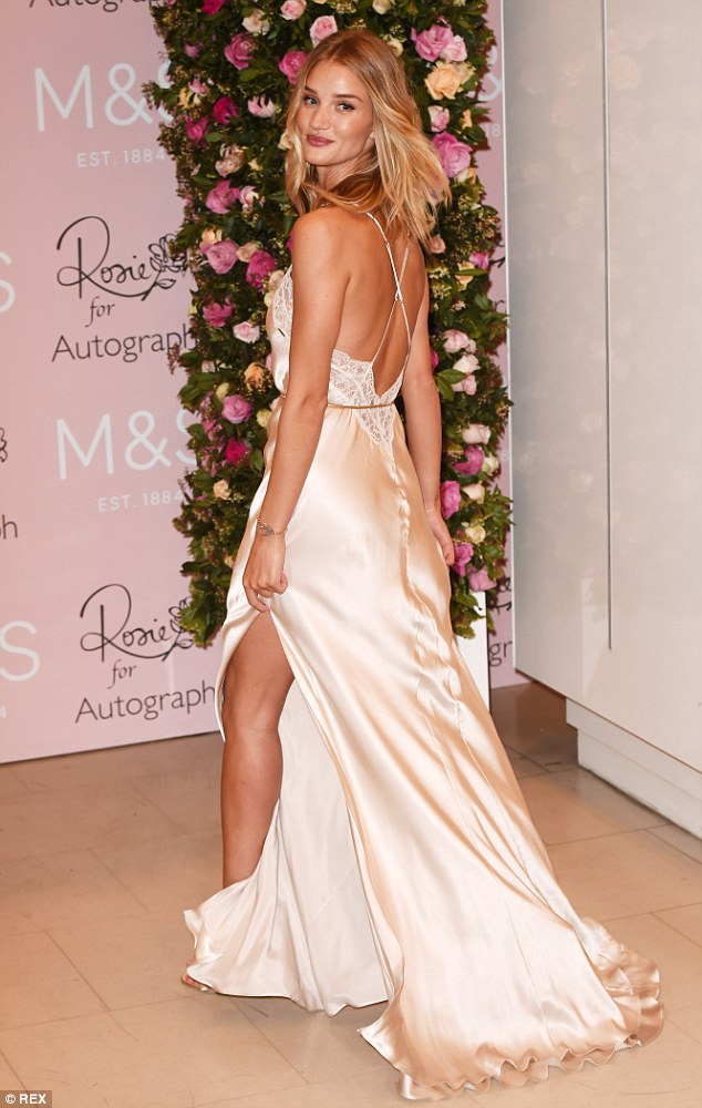 Her own best advertisement: Rosie Huntington-Whiteley wore a  nightgown from her own range at the Rosie For Autograph fragrance launch in London on Thursday