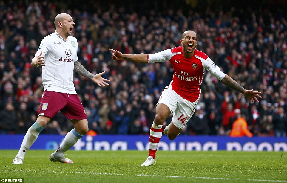 Walcott celebrates scoring his first Premier League goal of the season against Aston Villa in London