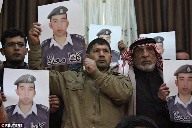Anger: Jordan had vowed to do 'everything' could to save the life of ISIS-held pilot Moaz al-Kasasbeh. Here Kasasbeh's relatives hold posters of the captive during a rallyin the city of Karak over the weekend