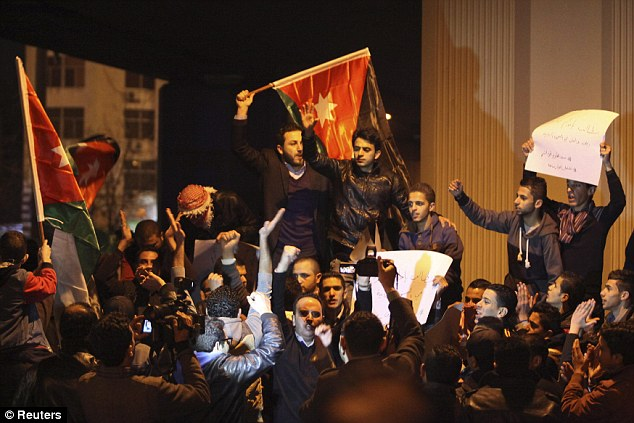 Activists took to the street in Amman to protest and wave their flags in defiance of the shocking video