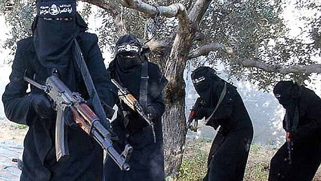 Extreme beliefs: The al-Khansa Brigade (pictured with automatic weapons) has said children as young as nine should be encouraged to marry and it is women's duty to obey men - who are their masters