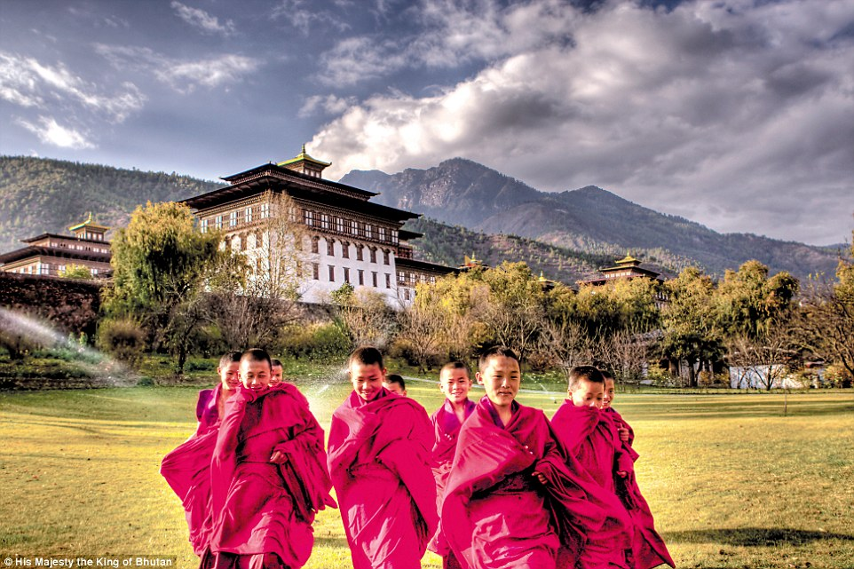 Young Buddhist monks gather in front of the King's Palace in the capital city, Thimpu, in this photo, taken by His Majesty the King of Bhutan