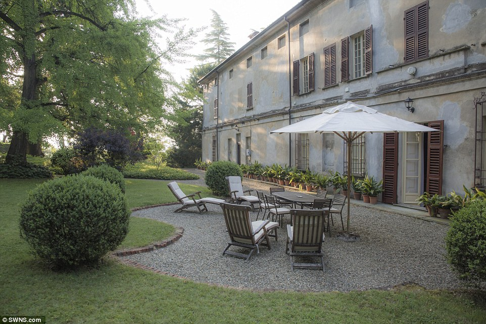 In the shade: The property in in Piedmont, Italy, has beautiful formal gardens and terraces along with a vineyard