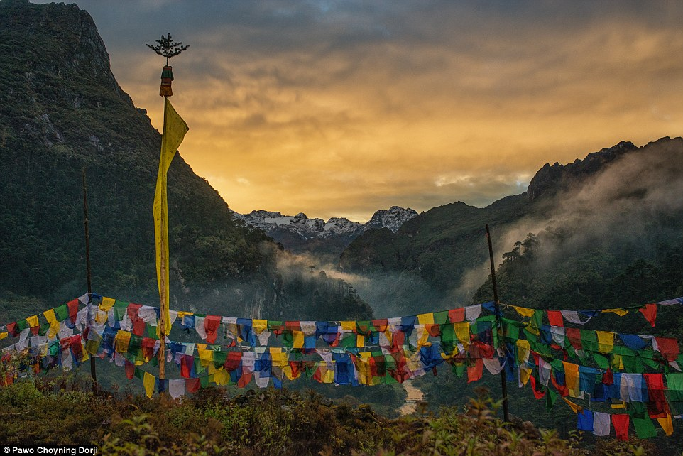 Tibetan prayer flags overlooking Himalayan Mountains. In Bhutan, prayer flags are hoisted for happiness, long life, prosperity, luck and to offer karmic merit to all sentient beings. When someone dies, prayer flags are believed to guide the soul of the dead away from the netherworld