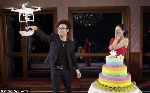 Special delivery: Crouching Tiger actress Zhang Ziyi is stunned when her boyfriend Wang Feng proposes using a drone to deliver the ring during her 36th birthday celebration on Saturday