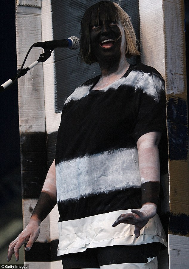 Reluctant star: The naturally shy songstress has always been uncomfortable with fame and has taken to wearing masks and heavy paint to obscure her face on stage