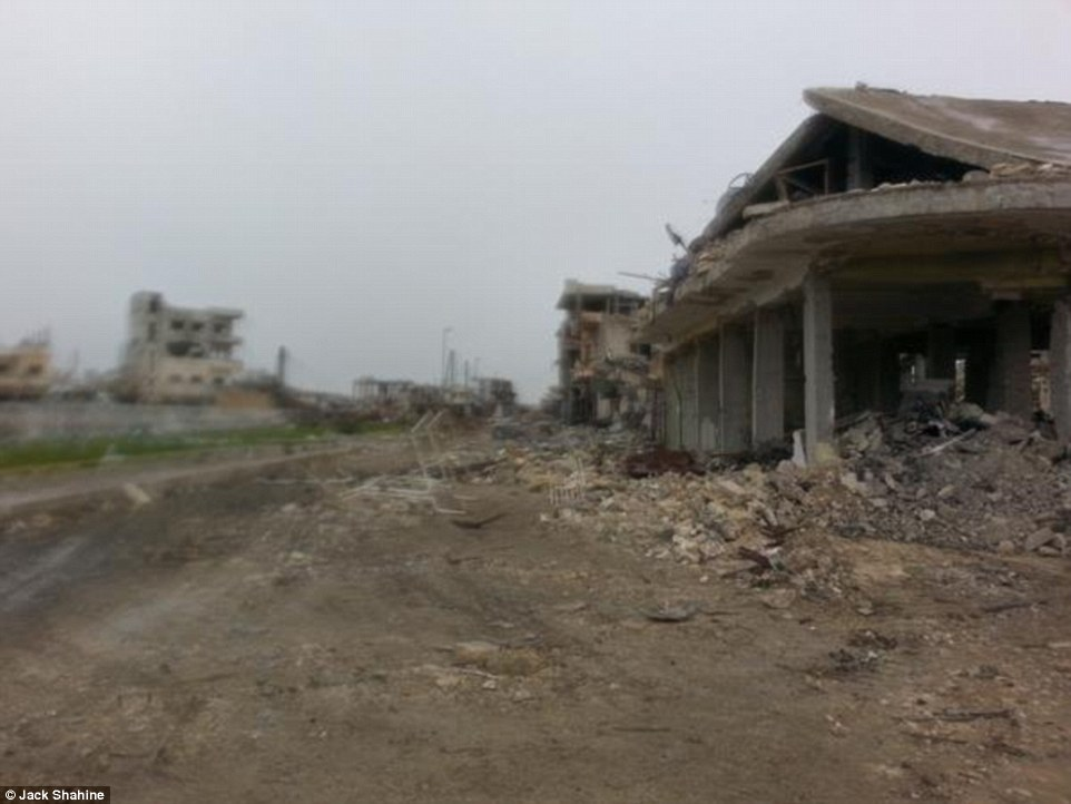 The main road between Kobane's Municipality Square and Freedom Square is photographed as barely passable