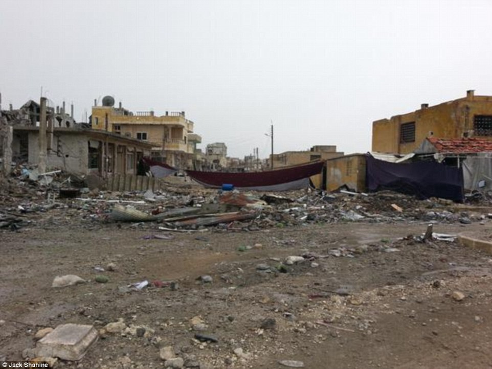 Destroyed: A street lined with school in the centre of Kobane is seen in ruins following the Islamic State's bombardment