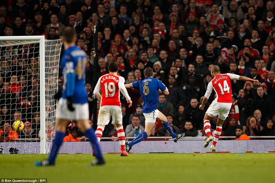 Walcott beats the Foxes defence to the loose ball to drill it into the back of the net beyond the keeper