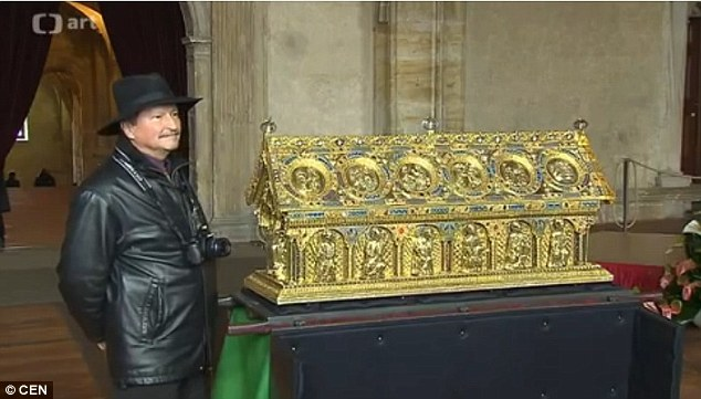 Nemesis:Frantisek Maryska, the former head of the Czech FBI, stands alongside the 'lost ark' triumphantly after he beat Douglas to the prize