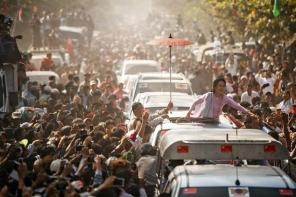 Myanmar opposition leader Aung San Suu Kyi greets supporters at a ceremony to mark honour her independence hero father Aung San, in the town of Natmauk on Fe...