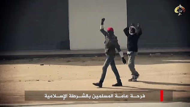 Support: The parade of Toyota Land Cruisers is welcomed by the locals in Benghazi. The video was posted by terrorist group Ansar Al-Sharia - who pledged allegiance to Islamic State last October