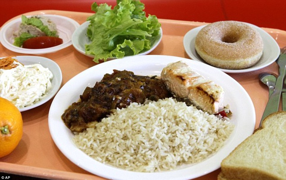 In France, school lunch is an art form: hot, multi-course and involving vegetables. A meal of rice, salmon, ratatouille, a slice of bread, a salad with celery and carrots, and an orange and donut at the Anne Franck school in Lambersart, northern France