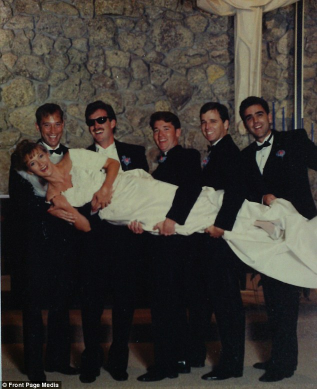 Wedding day: Tim Tobin and his groomsmen with his new bride Deb