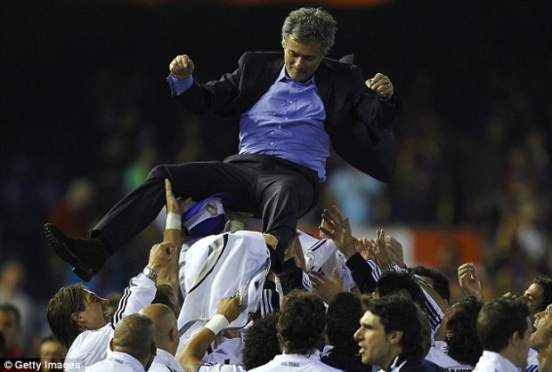 Jose Mourinho (top) is thrown into the air by his Madrid players after winning La Liga in 2012
