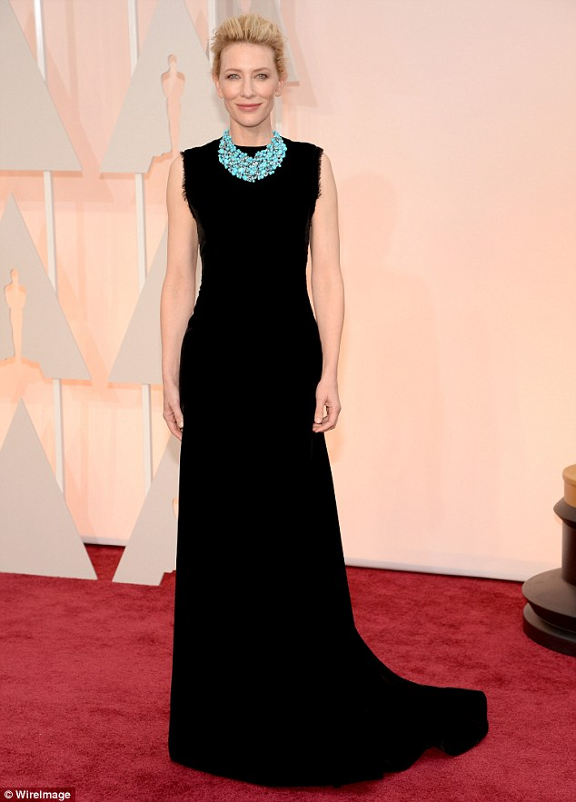 Statuesque: Cate Blanchett stuns in a long black  sophisticated John Galliano for Maison Margiela dress which she teamed with a statement Tiffany And Co. turquoise necklace