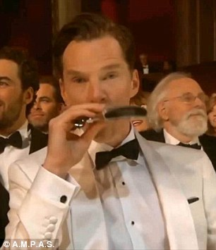 Ready for the worst: Benedict jokingly drank from a hip flask during the opening monologue