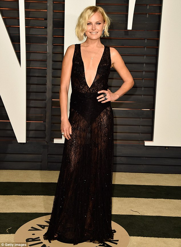 We can see you: Malin Akerman chose a revealing black dress with a plunging neckline for the Vanity Fair Oscar party at Wallis Annenberg Center For The Performing Arts on Sunday in Beverly Hills