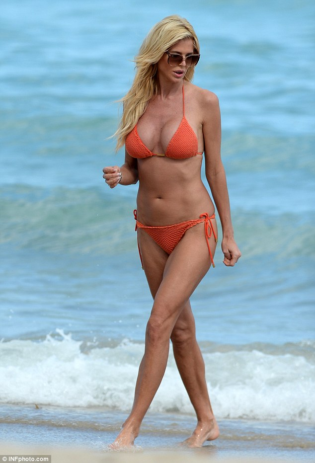 Swedish model Victoria Silvstedt caught the eye in a striking orange bikini as she topped up her tan in Miami on Monday