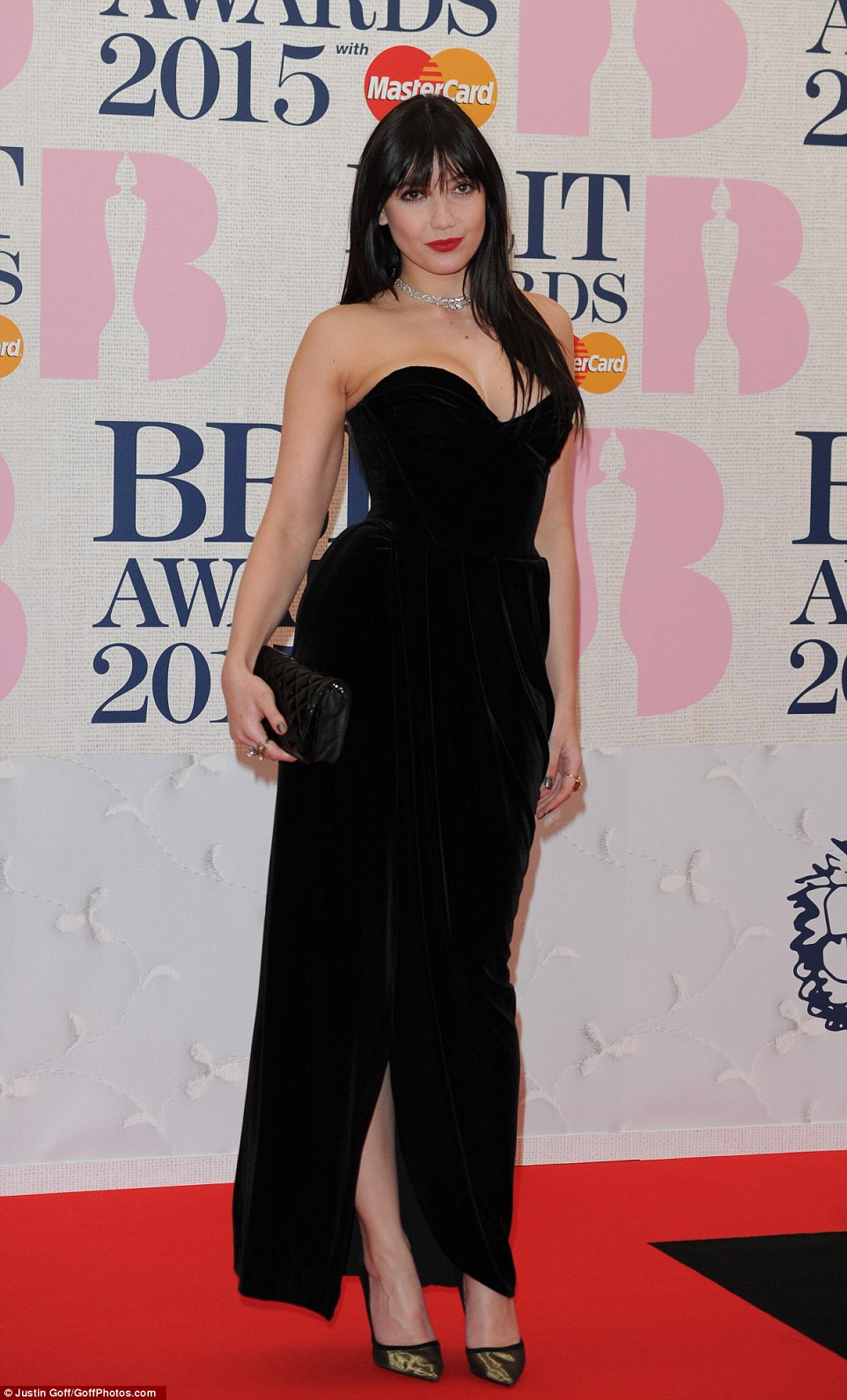 Model behaviour: Daisy Lowe looked beyond stunning in a black strapless gown after a week of non-stop partying