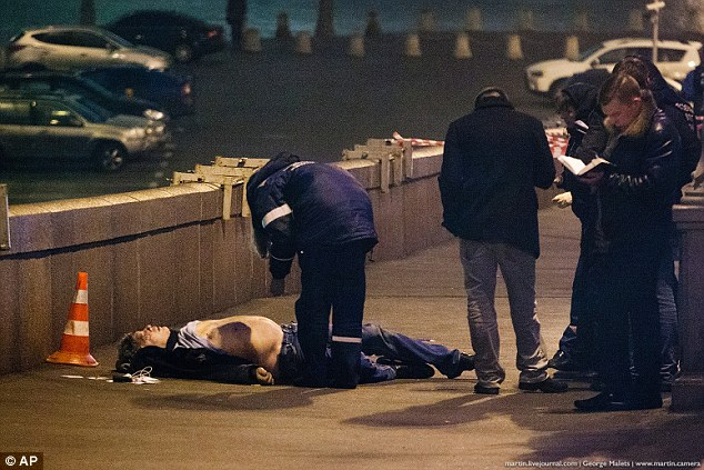 The father-of-four was shot four times by assailants in a white car as he walked across a bridge over the Moskva River