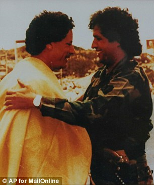 Warning: Gaddaf al-Dam says that the situation in Libya is now a 'thousand times worse' than when Gaddafi (pictured together left) was in power. He was a former intelligence officer (right) in Libya