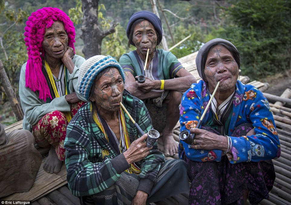 Relaxed: Most of the women smoke tobacco in their clay pipes, from which they are rarely parted