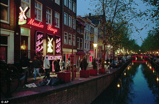Visit: McSweeney and fellow predator John Stingemore travelled to Amsterdam, visiting sex shops in the red-light district