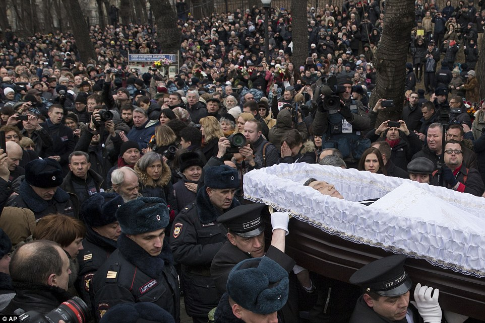 Mourners follow the open-coffin of Mr Nemtsov during a farewell ceremony at the Sakharov centre on Tuesday