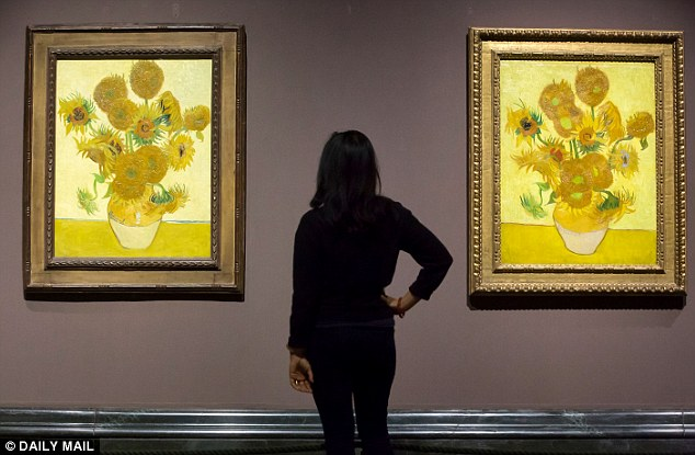 The colours in Van Gogh's masterpiece Sunflowers, two versions of which are shown above on display at the National Gallery, are feared to have also changed as the yellow and red pigments have degraded over time