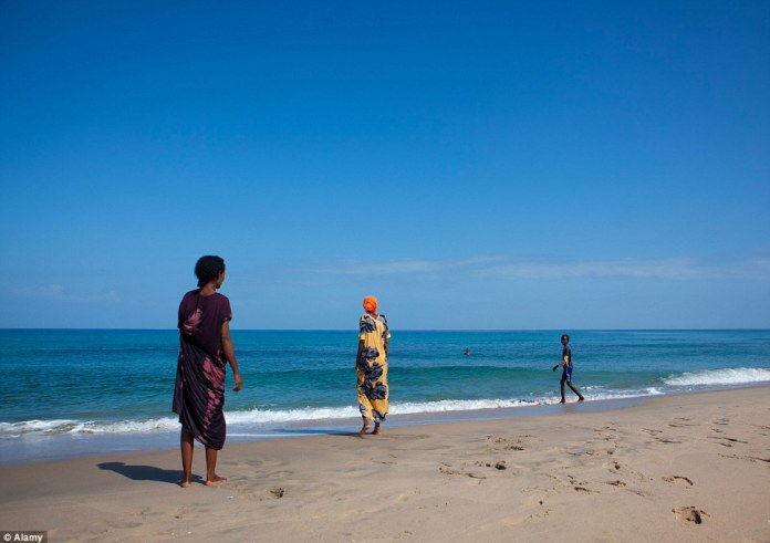 Locals walk along some of the 528 miles of beachfront in Somaliland that the country is keen to promote